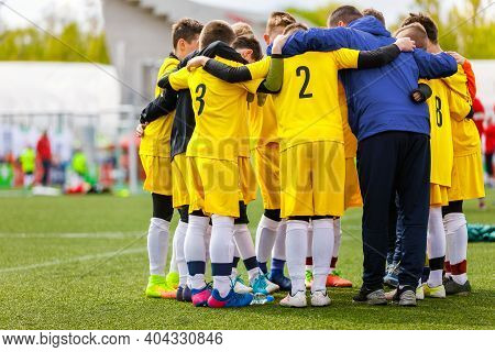Teenage Boys In Sports Team. Boys Huddling In A Circle With Coach Before The Final Game. Coach Givin