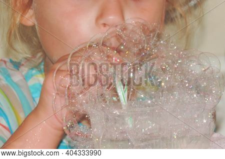 Close Up Child Blows Bubbles Through A Plastic Tube Made Of Soap Foam, Kids Fun Games, Diy Soap Bubb