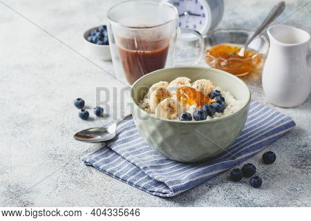 Breakfast With Milk Rice Porridge With Banans, Blueberry And Orange Jam, Creamy Rice Pudding Or Fren