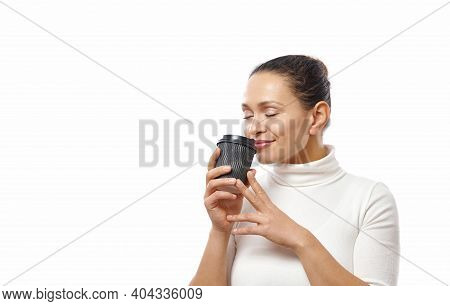 Beautiful Brunette Woman Enjoying Aroma Of Coffee In The Takeaway Paper Cup. Side Portrait Isolated