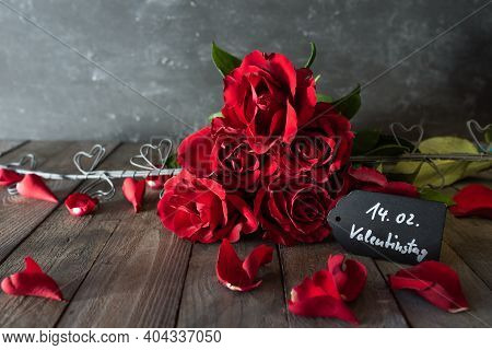 Red Roses Bouquet For Valentines Day Dekorated On Rustic Wooden Boards. Romantic Still Life For Vale