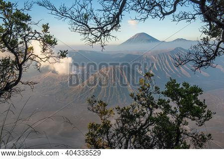 Spectacular View Of Mount Bromo At Dawn View Look Through The Natural Frame. This Is An Active Volca