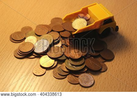 Toy Dump Truck With Coins On The Table