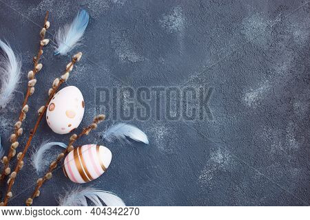 Easter Greeting Card Concept. Easter Eggs With Willow Branches On Blue Art Background. Flat Lay, Cop