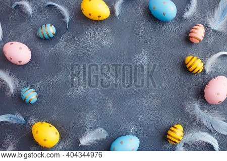 Easter Greeting Card Concept. Easter Colored Eggs With Feathers Frame On Blue Art Background. Flat L