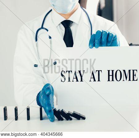 Close Up. Epidemiologist Indicating A Safe Distance .