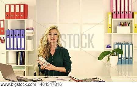 Saving And Finance Concept. Businesswoman In The Office With Money Banknotes. Save Money For Future