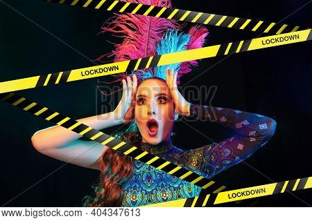 Beautiful Young Woman In Carnival, Stylish Masquerade Costume With Feathers Behind Limiting Tapes Wi