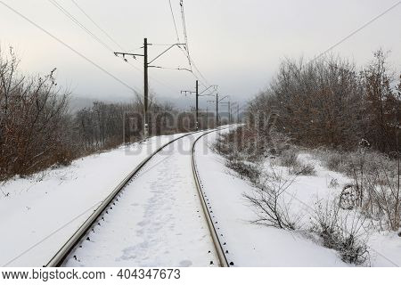 Snow covered railway in winter time