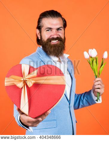 Boxing Day. Formal Party Dress Code. Bearded Hipster Hold Tulip Flower Bouquet. Holiday Present Conc
