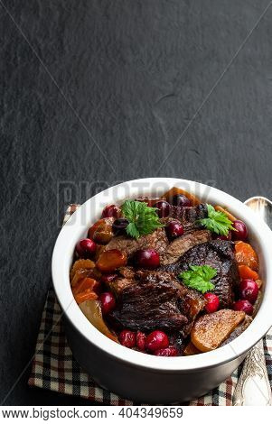 Braised  Beef With Cranberries In Clay Bowl Isolated On White