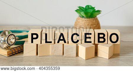 Placebo Word Written On Blocks. Fake Medical Treatment