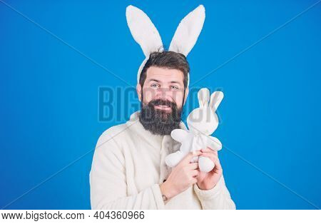 Guy Bearded Hipster Cute Gentle Bunny Long Ears Blue Background. Respect For Traditions. Easter Bunn