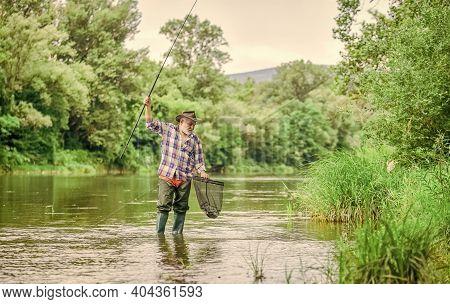 Cool People Do Fishing. Summer Weekend. Big Game Fishing. Mature Man Fly Fishing. Man Catching Fish.