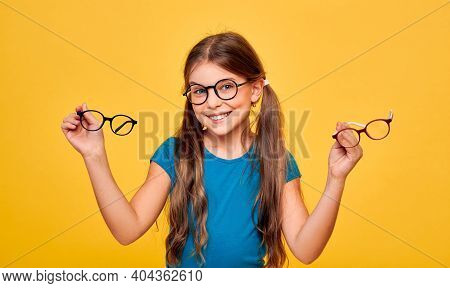 Vision Correction With Childs Eyeglasses. Funny Girl Wearing Glasses Holding Stylish Eyeglasses