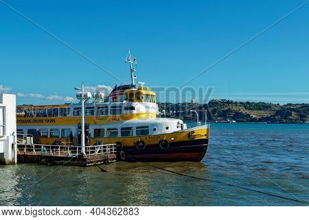 Lisbon, Portugal - October 01, 2019:  The Sightseeing Tour Boat Docks At The Pier At Tagus River Nea