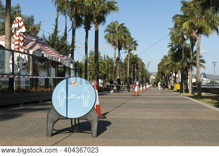 Limassol, Cyprus, January 20th, 2021: Social Distancing Signboard And Traffic Cones With A Barricade