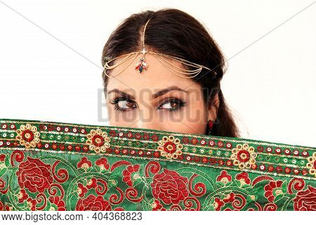Woman Dancing Indian Dance In National Dress. A Handsome Beautiful Girl Portrait In Red Hindu Saree,