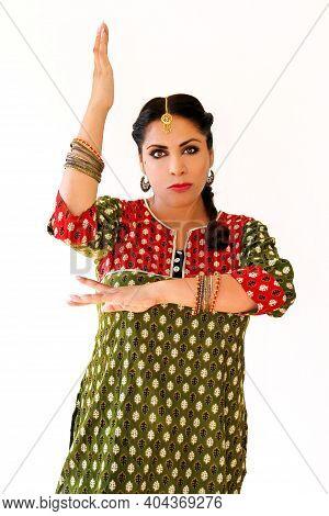 Woman Dancing Indian Dance In National Dress. A Beautiful Girl Portrait In Shree Kurta Patiala Set S