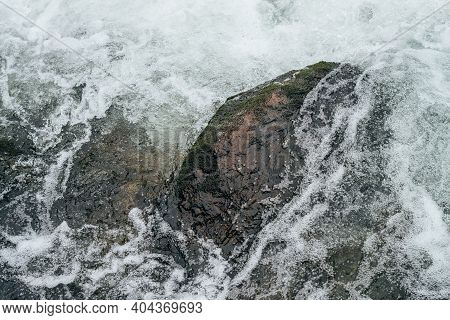 Full Frame Nature Background With Boulders In Water Riffle Of Mountain River. Powerful Water Stream