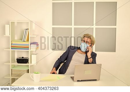 Man Freelancer Working Online. Guy Wear Mask While Surfing Internet. Limit Spread Of Disease. Remote