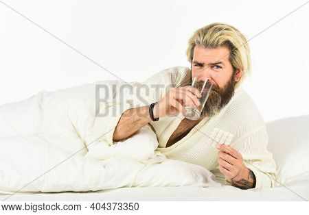 Handsome Man With Pill And Glass Of Water. Take Painkillers. Treatment Concept. Healthcare Take Medi