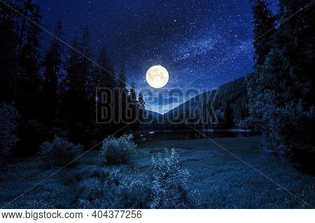 Mountain Lake Landscape In Summer At Night. Beautiful Scenery Of Synevyr National Park. Body Of Wate