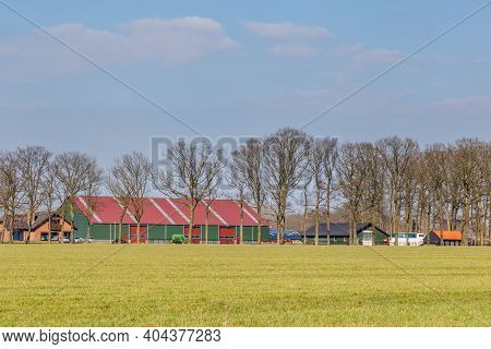 Gelderland, Netherlands - March 24, 2018: Modernl Dutch Farmhouse And Sheds On The Dutch Countryside