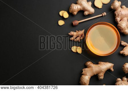Ginger And Honey On Black Table, Flat Lay With Space For Text. Natural Cold Remedies