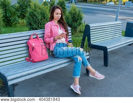 Woman In City On Bench In Summer, Reads Writes Message In Chat, Social Networks On Internet, Applica