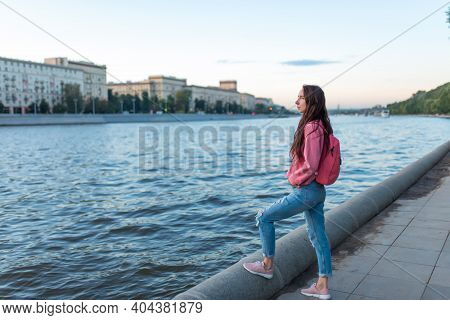 Woman In Summer In City Stands By River Bank, Free Space For A Copy Of The Text, A Date And Meeting