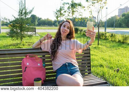 Woman In Summer In A City Park Recording Online Video On Phone, Broadcasting Social Networks Applica