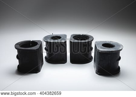 Rubber Bushings Anti-roll Bar Silent Blocks New In Contrasting Light On A Black And White Background