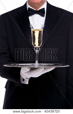 A butler serving a glass of champagne on a silver tray, on a white background.