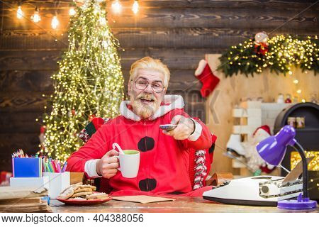 Santa Claus. New Year Gifts. Merry Christmas. Santa Claus Costume. Santa Claus Sit At Table. Christm