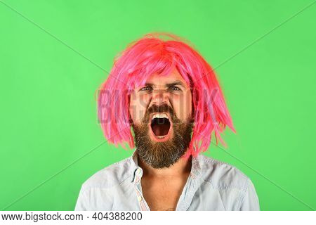 Angry Man Portrait. Man In Color Wig. Angry Man. Brutal Bearded Man. Portrait Of Serious Men. Isolat