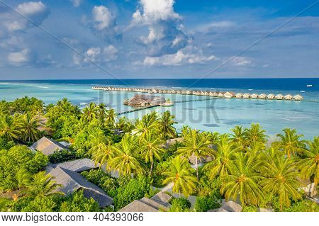 Beautiful Drone Aerial View In Maldives. Panoramic Aerial View Of A Tropical Island In The Indian Oc