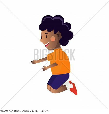 Little African Boy Wearing Shorts, T-shirt And Sneackers Kneeling.