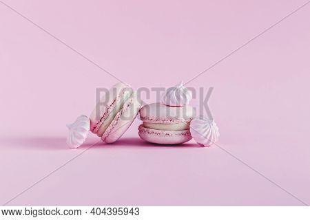 Pink Pastel Macarons With Marshmallows On A Pink Pastel Background. Place For Text.