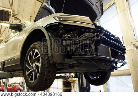 Moscow - Russia - October 13 2020: The Car In The Car Service Is Raised On A Lift. Front Bumper Remo
