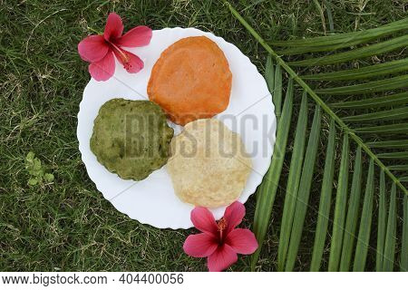 India Tricolor Tricolour Food Breakfast Of Spinach Puri, Carrot Puri, And Plain Puri. Concept For In