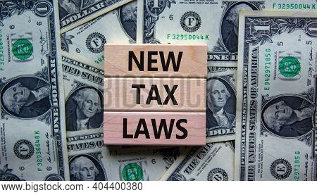 New Tax Laws Symbol. Concept Words 'new Tax Laws' On Wooden Blocks On A Beautiful Background From Do