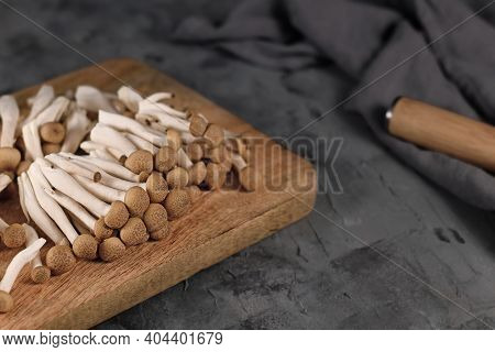 Brown Edible Mushrooms Native To East Asia Called Buna Shimeji On Wooden Cutting Board