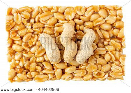 Peanut Brittle Bar Isolated On White With Whole Groundnut In Shell