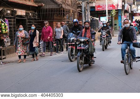 Kathmandu, Nepal, 17 March 2020: People Wearing Protecting Masks For Protection From Covid-19 At The