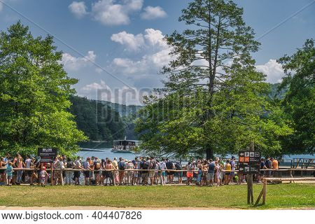 Plitvicka Jezera, Croatia, July 2019 Big Crowd And Queue Of Tourists For Ferry To Cross The Lake In