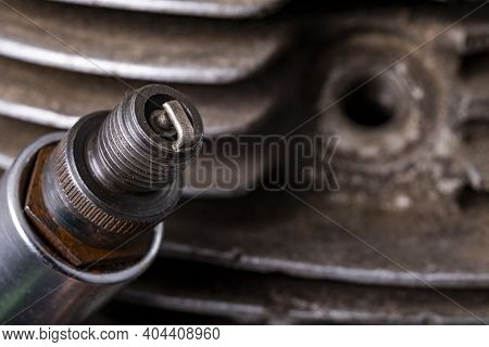Spark Plug On The Background Of The Internal Combustion Engine. Minor Repair Work On The Internal Co