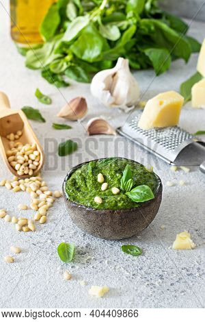 Green Pesto In A Bowl Made From Fresh Basil Leaves, Pine Nuts, Parmesan, Garlic And Olive Olia On A