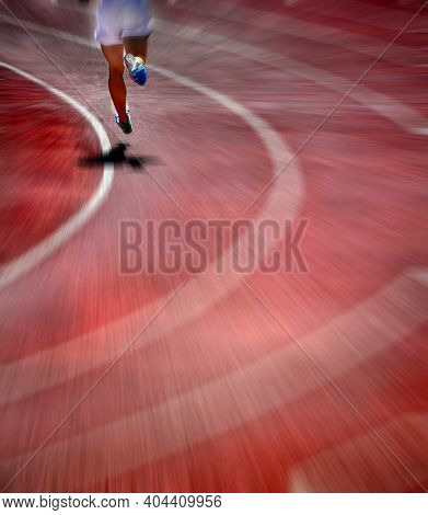Runner on lanes of a red race track with a curve at the end fast speed sprint