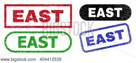East Grunge Watermarks. Flat Vector Grunge Stamps With East Tag Inside Different Rectangle And Round